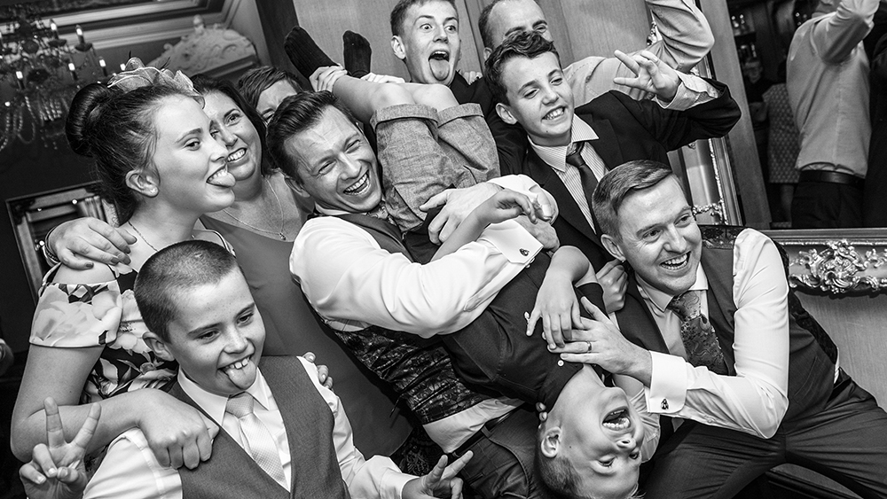 group having fun in front of selfie mirror,gay wedding
