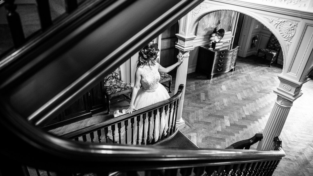 bride leaning on banister
