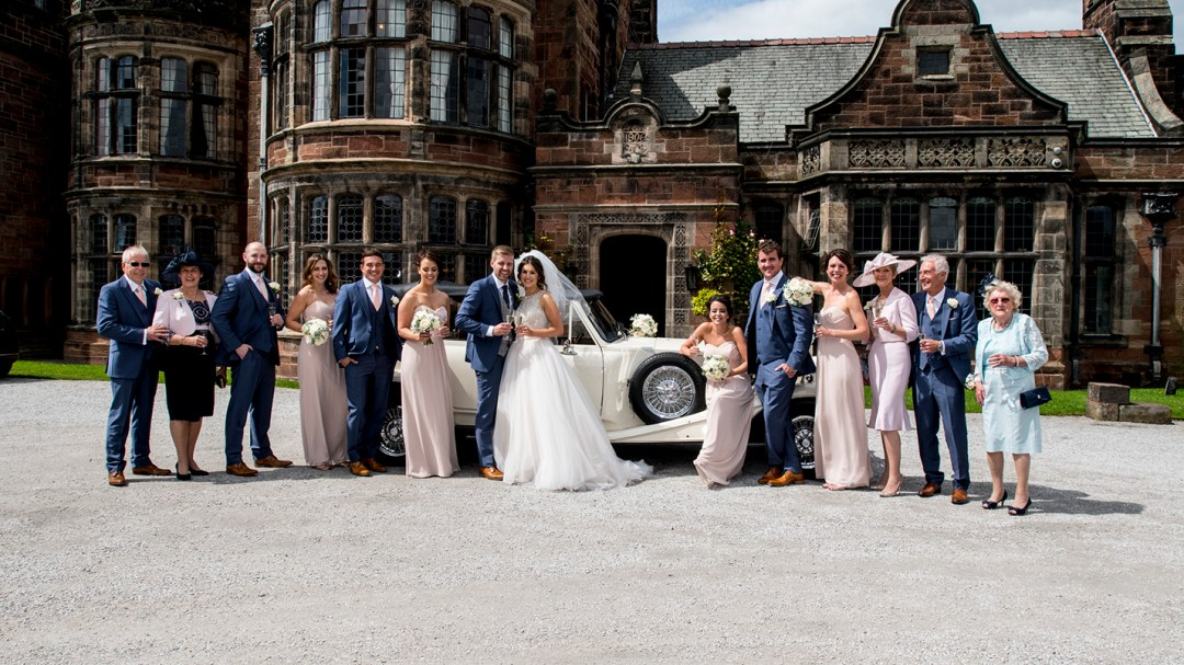 Bridal party by wedding cars at Thornton Manor