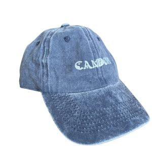 Candor baseball-style cap, against a plain white background. Cap is made out of a blue denim-style fabric with enzyme dye wash and has the Candor text logo embroidered centre front.