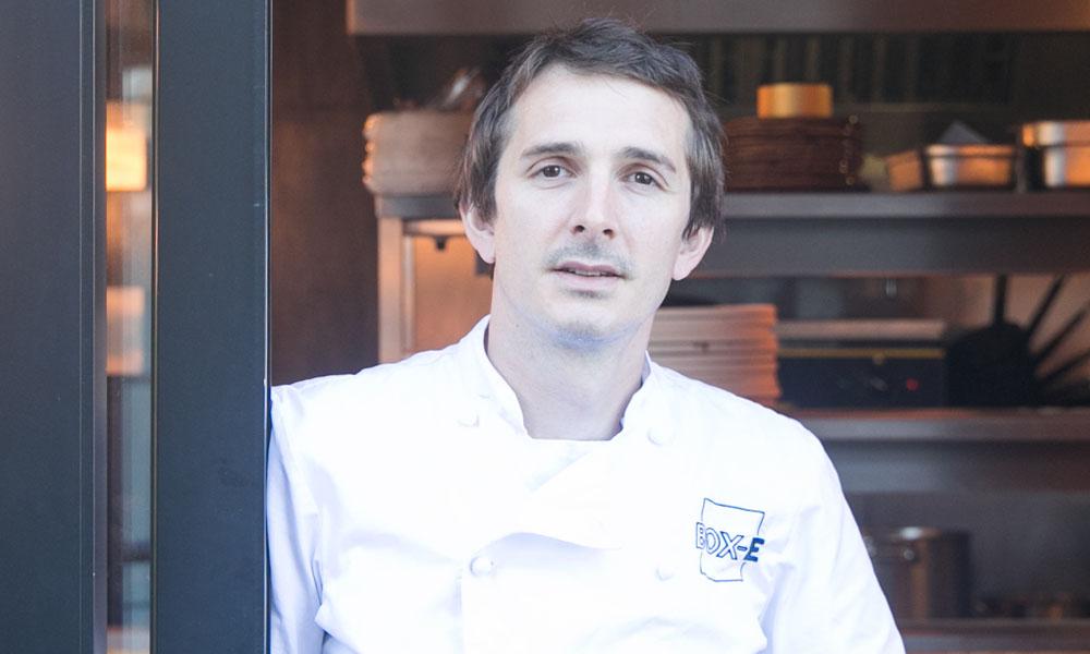 chef elliott lidstone at the entrance to his restaurant, box-e bristol