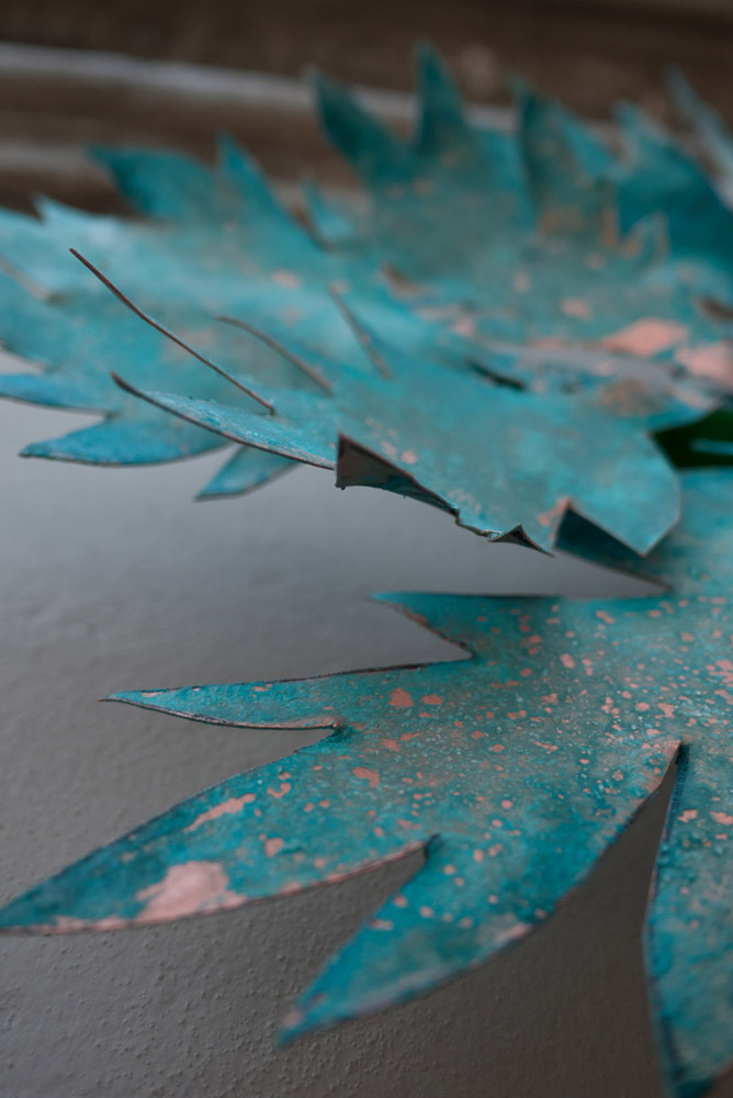 Detail of copper leaves with patina