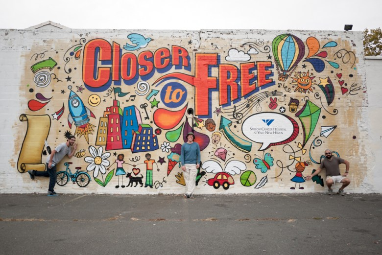 Closer to Free Mural,  Acrylic & Spray Paint, 30' x 18'. Left to Right:  Dana Woulfe, Caleb Neelon, and Josh Falk