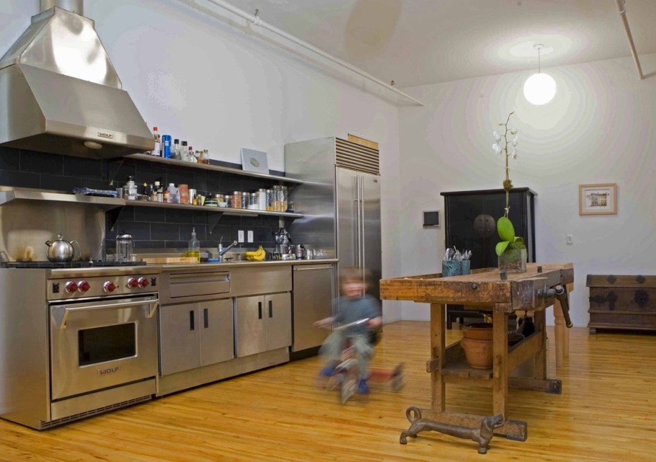 soho new york loft :: minimalist industrial kitchen w/room to ride ... minmal stainless steel kitchen with antique carpenter's workbench