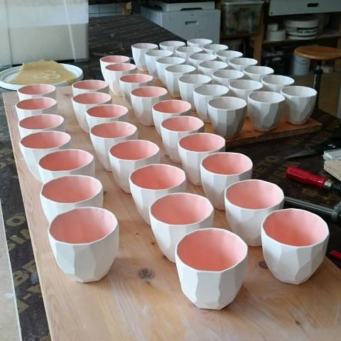 Glazing the poligon cups before these go into the kiln on 1240 degrees