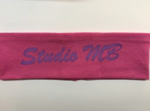 Pink Headband Purple Logo Text