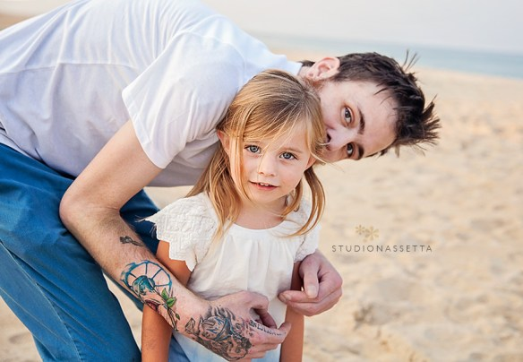 Photo of Uncle with tattoos hugging niece in Nags Head NC