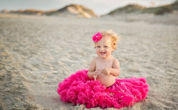 first birthday girl photo shoot with pink tutu on the beach in the outer banks of NC