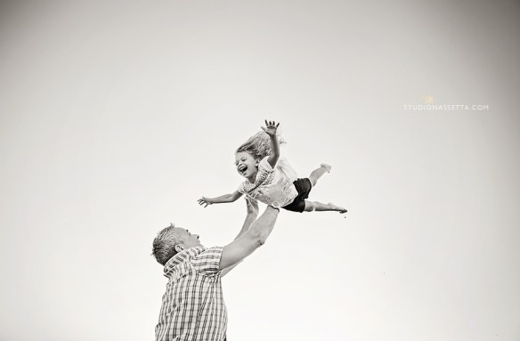 Award winning photograph of girl flying daddy - black white photo outer banks NC