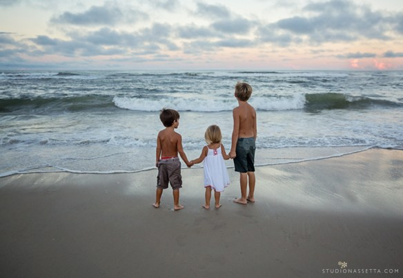 Best Outer-banks NC photographer, photograph of kids looking out at ocean sunset