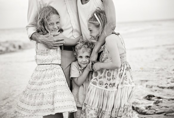 kids hug parents in family black and white portrait outer banks nc