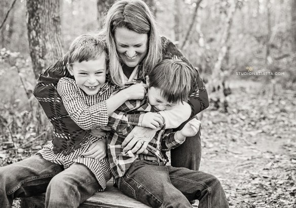 mom and boys hug laugh Nagshead woods NC