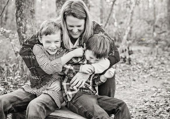 mom and boys hug laugh Nagshead woods NC