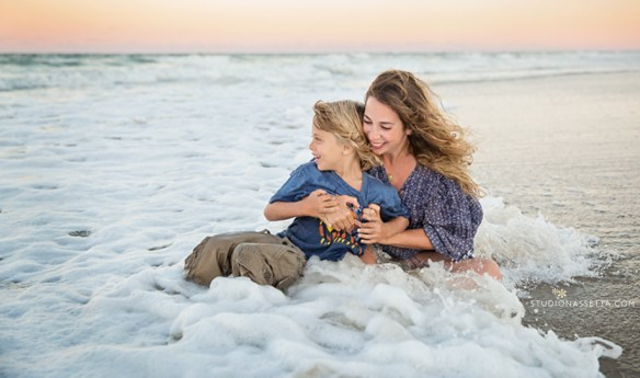mother and son playing in the waves with clothes in outer banks NC - photo
