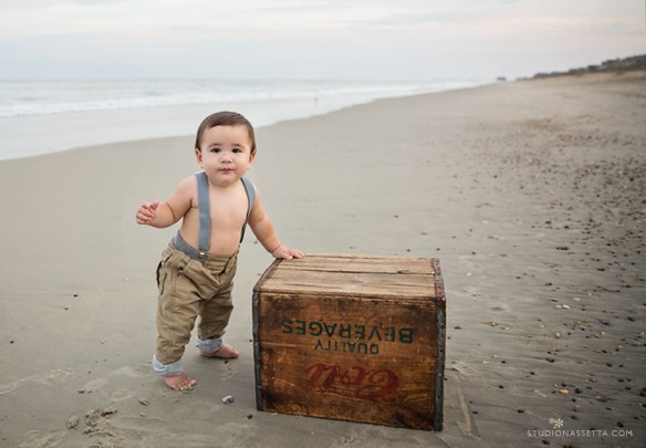 one year old boy photo shoot with suspenders on the beach at nagshead NC