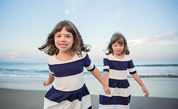 twin girls running on beach in corolla NC