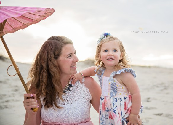 Photo of Woman holding pink parasol and daughter in Nags Head NC