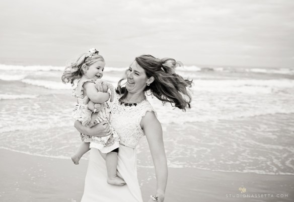 Mommy spinning daughter at the beach in Nags Head NC