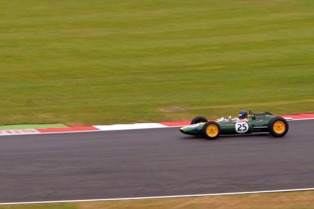 Damon Hill OBE driving Graham Hill's 1968 Lotus 49B, at Silverstone as part of their 50th Birthday Parade 05/07/2014.