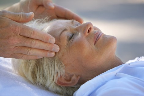 Senior woman having head massage, close up