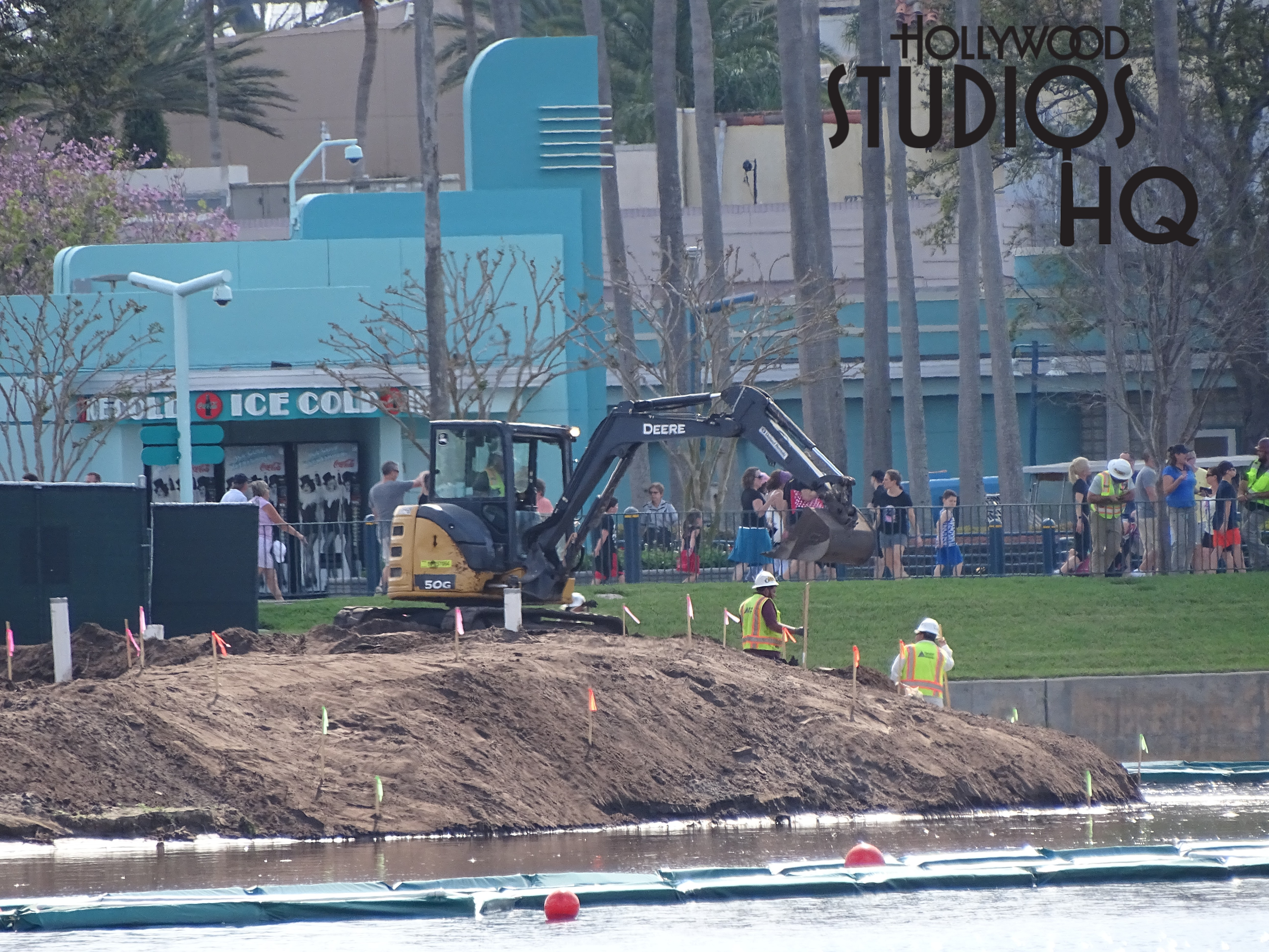 The Music parking lot has been reopened to guests from behind earlier erected construction walls to reveal one row of new LED technology lighting. Additional light fixture installation in this zone may be delayed in anticipation of the traditional large crowds soon arriving for spring break vacations during which time all available parking is vital. Numerous concrete barricades and other construction materials remain near the old parking ticket booth entrance off Lake Buena Vista…perhaps the old booth will be gone very soon. Meanwhile, construction crews are working steadily on the Studios future Skyline station. The gondola system's stop here upon final completion will keep with the theming of the front entrance to the Park with its Golden Era architectural style. Enjoy the new photos and video below to fully experience of all of this related construction work in progress this week outside of the park.