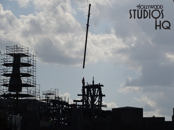 Now for a fresh look this week at the Batuu's construction effort which continues to reveal steady progress toward the 2019 opening. Crews were carefully lowering metal beams in place on a structure while the mountain that the workers were painting last week is almost completed. Notice in the photo below that construction vehicles are now positioned on the backside of the main building. Crews are likely racing against time to enclose key structures before the Orlando rainy season arrives in full force. Enjoy all the new photos and cutting edge video segments below for the most extensive weekly coverage of ongoing construction. Remember that Hollywood Studios HQ is the number one place for accurate and comprehensive news updates on Star Wars Galaxy's Edge as well as many more exciting and unique aspects…found only at Disney's Hollywood Studios. Photo by John Capos