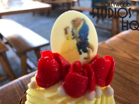 """A delicious """"Tale as Old as Time"""" treat now awaits guests at the Sunset Ranch Market. Get ready to enjoy this brand new raspberry-filled vanilla cupcake with tasty yellow buttercream icing. Whether purchased before or after viewing the Beauty and the Beast stage production directly across the street, this tempting delight is available for $5.99. This new cupcake selection replaces The Wrinkle in Time themed cupcake that has been a favorite for some time at the Sunset Ranch Market. Disney's Hollywood Studios. Photo by John Capos"""