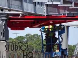 Arriving Park guests may have spotted the newly installed giant Disney Skyliner cable wheel that will help guide gondola transportation vehicles arriving and departing from the Hollywood Studios station. This giant bright red horizontal mechanism just put into place under a tower was being tested by workers during the day. With tower erection now completed on Park property for the Caribbean Beach Resort route, construction focus appears to now be centered on completion of the Hollywood Studios station. Disney's Hollywood Studios. Photo by John Capos