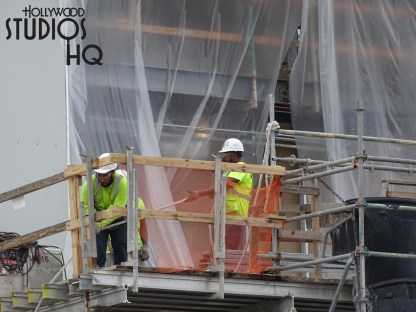 Workers were busy on a high platform fastening plastic sheeting over a remaining wall opening, likely in anticipation of a return to inclement weather. Also pictured below is a view of the back wall of a major building awaiting installation of a remaining panel for final closure to the elements. An additional side wall near the Muppet Vision 3D on this same building still awaits numerous outside panels. Star Wars: Galaxy's Edge Disney's Hollywood Studios. Photo by John Capos