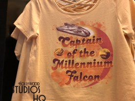 A colorful Star Wars Solo themed women's top and coordinating skirt featured inside Legends of Hollywood is perfect for Mother's Day gift giving. As pictured below, the top carries a Captain of the Millennium Falcon inscription while the coordinating skirt has a unique multi Star Wars character pattern. Additional Solo themed merchandise includes a new coffee mug, joined by a women's back pack, and matching wallet. Disney's Hollywood Studios. Photo by John Capos
