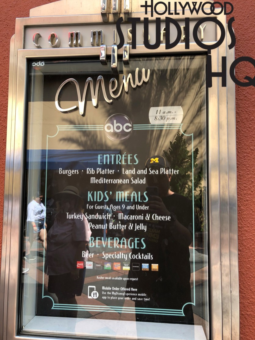 Outdoor menu displays to lure diners inside to ABC Commissary cuisine have been modified by removal of entree photos with simply menu choice selection descriptions remaining. Disney's Hollywood Studios. Photo by John Capos