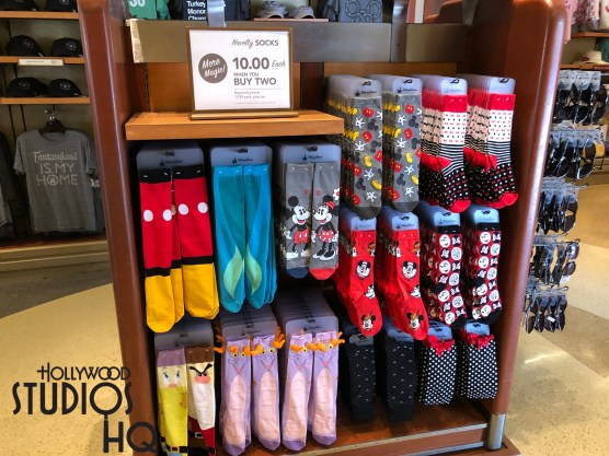Colorful Disney character socks and polos recently exchanged display locations with fancy Adventurers mugs inside the store for a new merchandising look. Shoppers can now locate their choice mug on a wall display and still stop by to select socks in the middle of the store. A choice of Disney socks enable fans to exhibit their Disney loyalty any day of the year. Disney's Hollywood Studios. Photo by John Capos