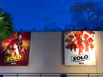 Two new giant billboards mounted on the Little Mermaid attraction building greet guests entering the Animation Courtyard area. Having replaced the prior The Last Jedi blue ray release announcement, these colorful posters picture all the main film characters ready to invade theaters beginning May 25, 2018. These outdoor announcements arrived just in time to enhance the May 27 Galactic Nights special event atmosphere. Disney's Hollywood Studios. Photo by John Capos