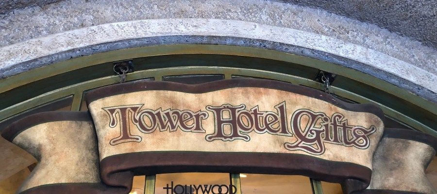 Once guests return to the ground floor of this attraction, new Hollywood Tower Hotel (HTH) themed clothing and accessories await them. Shoppers can select from a black and white frightened expression Mickey Mouse tee shirt or Tip Top Club tee promoting dancing and dining. New selections also include a novel glow in the dark black and white tee shirt picturing those unfortunate souls at the time of the Hotel's lightning strike. Guests enthralled with the number 13 have their own themed design shirt featuring a V neck style. A tee shirt highlighting simply the HTH logo as well as a red top complete with a female image highlighted by a large HTH logo earring are also on display. Merchandise shelves include coordinating HTH accessories with handbags and scraps. A colorful women's light blue top with a repeating pattern of floral arrangements rounds out the new items just in at Tower Hotel Gifts. Disney's Hollywood Studios. Photo by John Capos