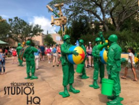 Those favorite green army men are present in life size statues poised to look for Woody's return while helping to string lights and snatching a quick snack from his lunch box. A huge Jesse figure assisted by Rex the Dinosaur balancing on top of stacked jengo blocks together is around the Slinky Dog Dash coaster. Meanwhile, live action green army men characters delight guests with a mini drum line procession as well as entertain small guests with boot camp play time activities. Toy Story Land. Disney's Hollywood Studios. Photo by John Capos