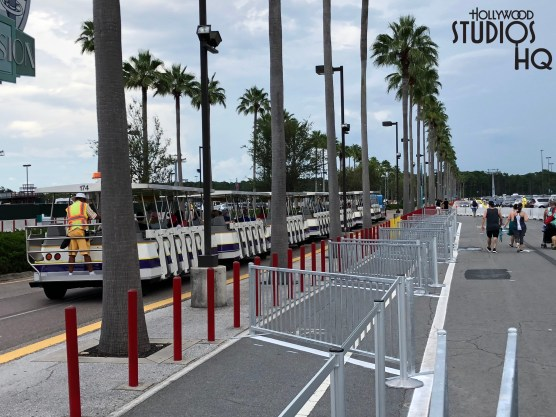 Guests arriving to vehicle parking will find a brand new tram loading and walkway configuration. Due to construction in the former resort bus and handicap parking areas, arriving guests will now utilize a single tram loading location solely at the edge of the television parking section. Tram drop off has also been relocated to the edge of the film parking section. From this drop off point, the remaining guest foot traffic route to arrive at the Park main entrance follows a new walk way directly through the former resort bus and handicap parking area. Construction walls featuring images of the future Star Wars: Galaxies Edge land images border this new walk way on both sides for guest safety. Meanwhile, the three Guest Relations walk up service windows and the restrooms near the former tram loading zone are still open and accessible near the main entrance ticket area. Disney's Hollywood Studios. Photo by John Capos