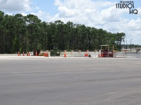 Construction continues on the future guest vehicle entrance roadway and expanded parking. Recent paving is visible in photos below of the new general parking lot yet to open as well as the connecting roadways across from this area. The multi -booth vehicle ticket plaza structure has been painted in classic Hollywood Studios colors along with the individual attendant booths. Even the plaza lane open indicator lighting is also operating in preparation for the future grand opening of this new major entrance. Disney's Hollywood Studios. Photo by John Capos