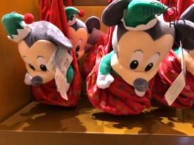 Merry and Bright Mickey themed holiday merchandise now awaits guests at stores throughout the park. Shoppers will want to purchase their very own Jingle Bell Glow Necklace to enjoy the season with colored glowing bells. Merchandise selections include Mickey themed holiday sweaters, carry bags, and even Christmas cards. A variety of tempting treats are available including packaged milk chocolate and ginger bread popcorn. A Baby Mickey plush complete with Santa cap or a Stitch character plush packaged with a reading books would make great family gifts. Guests can best track their holiday activities with their very own Count Down To Christmas calendar. Disney's Hollywood Studios. Photo by John Capos
