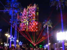 Complete with new laser enhancement , guests enjoy the holiday spirit with the opening of the Sunset Seasons Greetings projection show. This night time entertainment features Toy Story, Muppets, and Olaf themes underneath Disney's own brand of winter snowflakes. Disney's Hollywood Studios. Photo by John Capos