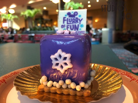 Two new seasonal cupcake selections await diners at the Park's counter service locations. The Olaf themed cupcake offers a rich chocolate cake center topped with light blue colored butter cream icing and sugar snow sprinkles. Peanut butter fans will enjoy the Flurry of Fun present shaped dessert with a delicious filling wrapped in a purple coat. Disney's Hollywood Studios. Photo by John Capos