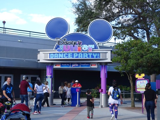 A colorful new entrance sign welcomes guests to the recently opened Disney Junior Dance Party. Stand-by, FastPass+ as well as show time information is displayed above a cast member podium. Stay connected to Hollywood Studios HQ for up to the minute entertainment news. Disney's Hollywood Studios. Photo by John Capos
