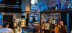 Universal Studios has reopened the Tribute Store to commemorate many features of Jurassic World. The front room is themed to the new Jurassic World VelociCoaster with a selection of VelociCoaster and dinosaur merchandise. Connecting rooms in the store have details of the Jurassic Park film sets as well as speciality foods including a chocolate dino-sized egg. Stay tuned to Hollywood Studios HQ. Universal Orlando. Photo by John Capos