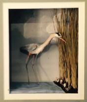 Carol Schmedinghoff, Great Blue Heron, hand carved bird set in marsh scene