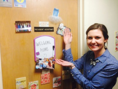 A person showcasing a welcome home sign