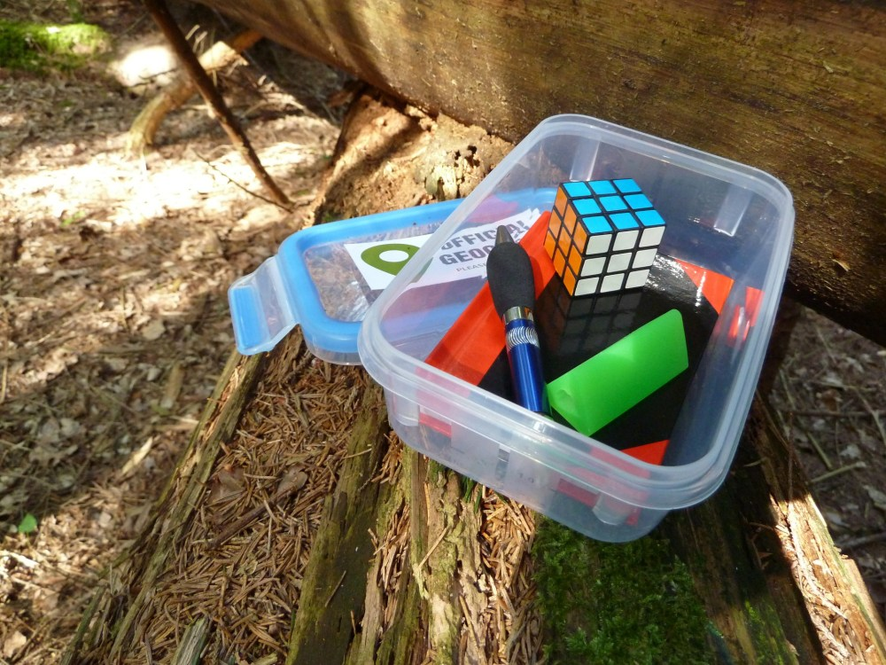 Geocachers are prone to leaving trinkets behind for others to find. (Image via prainc.com)