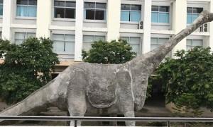 a concrete dinosaur