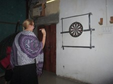 Hannah playing darts