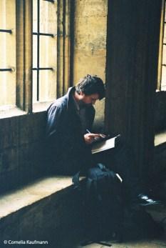 Student sitting in the cloister of Christ Church College. Copyright Cornelia Kaufmann