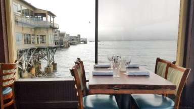 Love the pier dining room at The Fish Hopper; perfect for sealife spotting! © Stuffed Suitcase