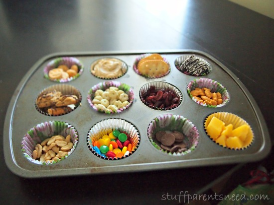 various snacks in baking cups inside a muffin tin